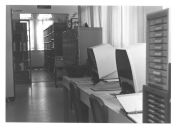 Microfilm machines and book shelf, Ancon Library