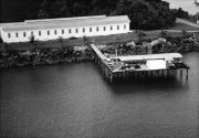 Aerial view of building and pier at Naos island