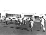 Staff and visitors, walking through Albook airport
