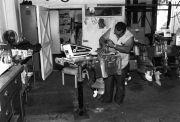 Daniel Vasquez, repairing a boat engine